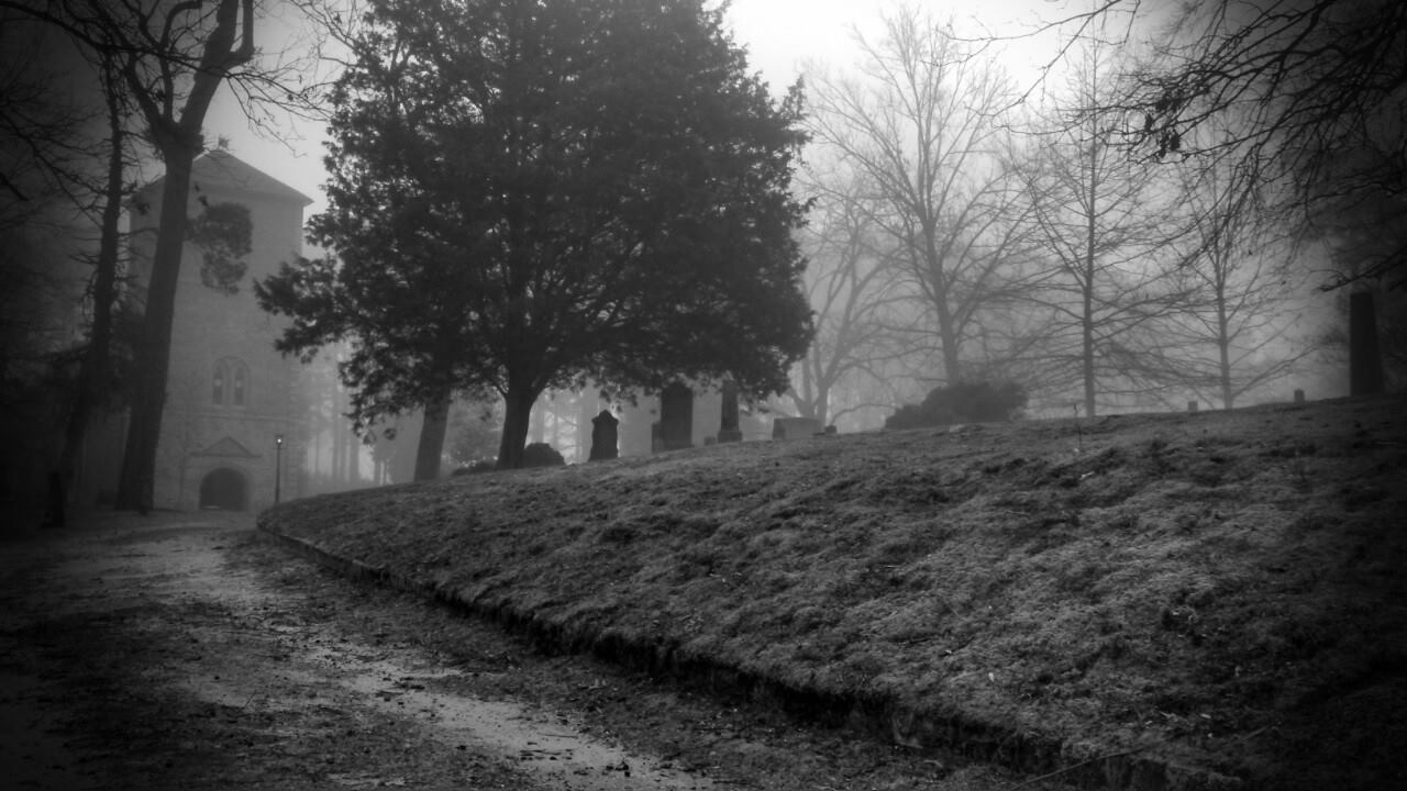 A foggy morning looking southeast across cemetery