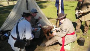 A photo of Civil War Reenactors gathered together.